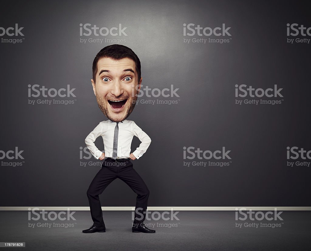 dancing businessman with big head stock photo