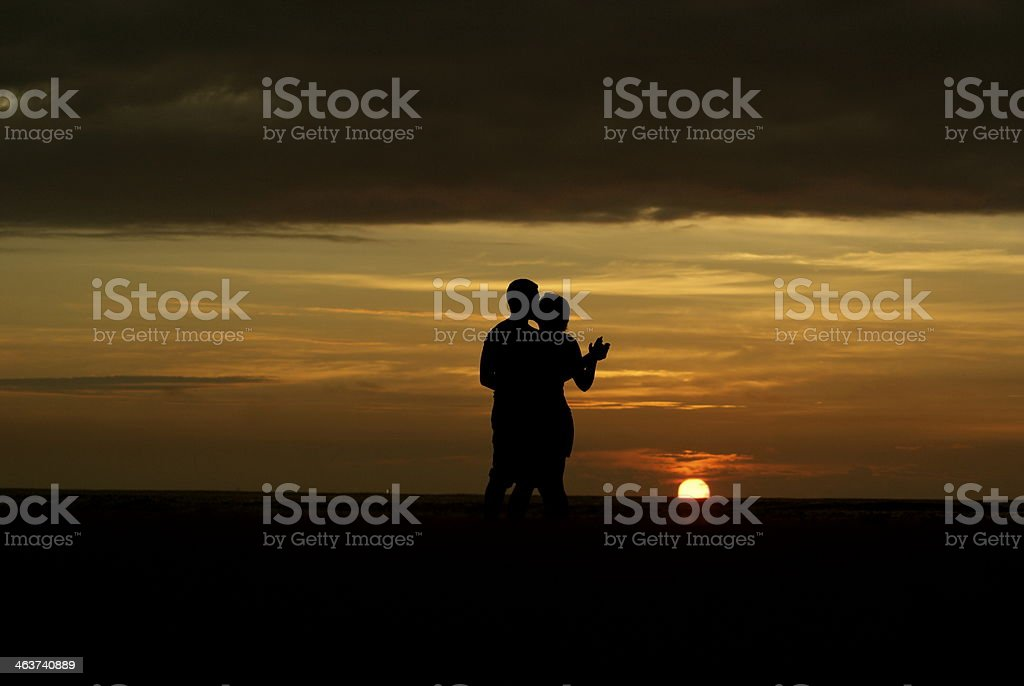 Dancing Couple During Sunrise stock photo