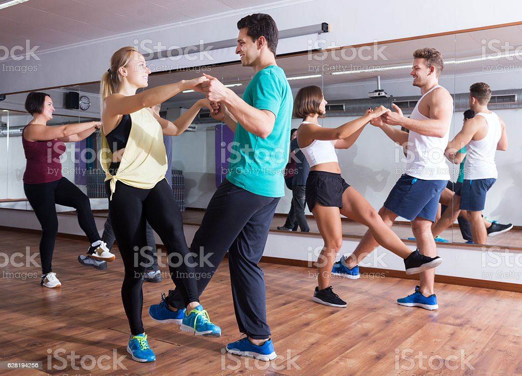Dancing couples learning swing stock photo