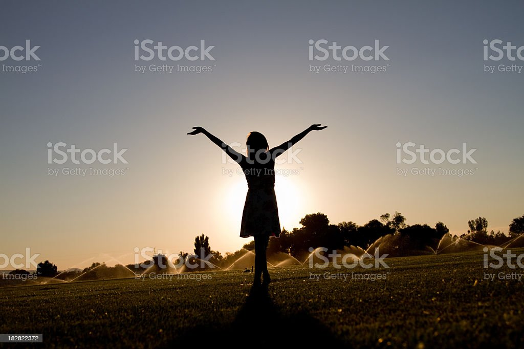 Dancing Girl Arms Up Silhouette Worship stock photo