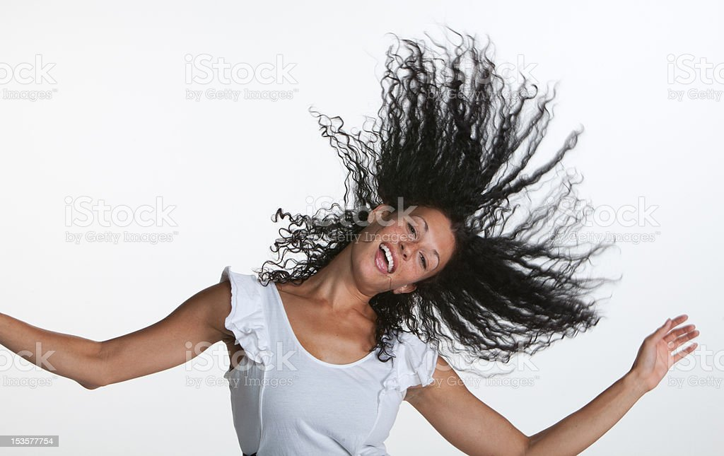 Dancing Girl Flips Hair Up stock photo