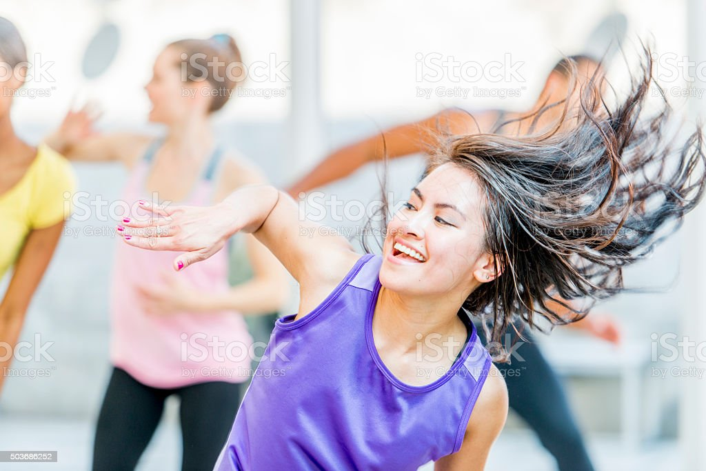 Dancing Happily in Fitness Class stock photo