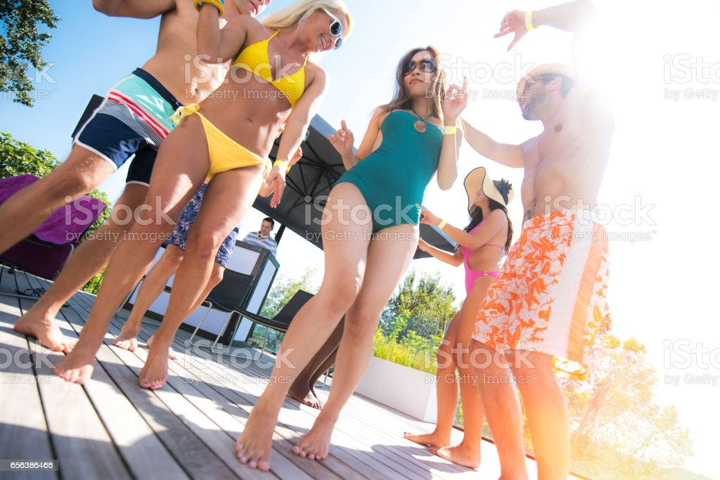 Dancing in swimwear stock photo