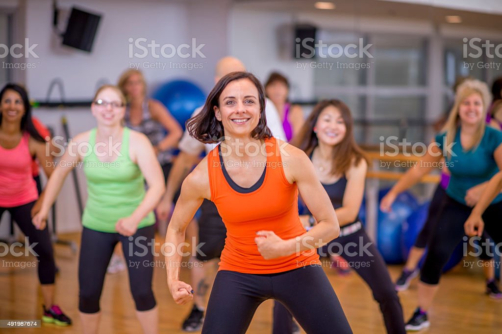 Dancing in Zumba Fitness Class stock photo