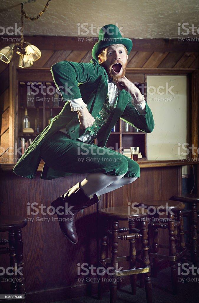 Dancing Irish Character / Leprechaun Man in Pub stock photo