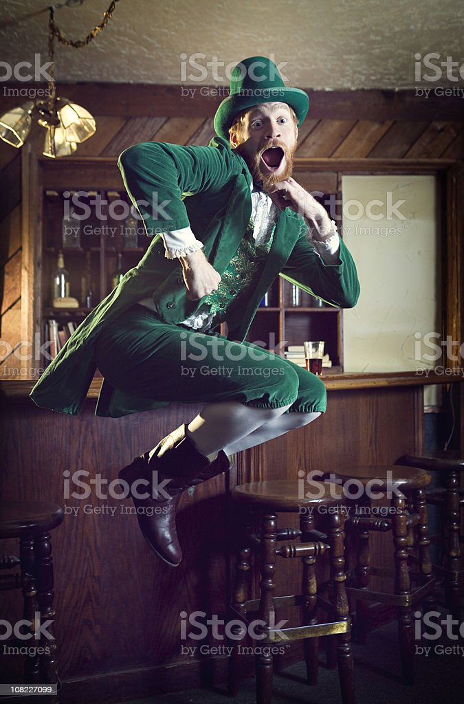 Dancing Irish Character / Leprechaun Man in Pub stock photo