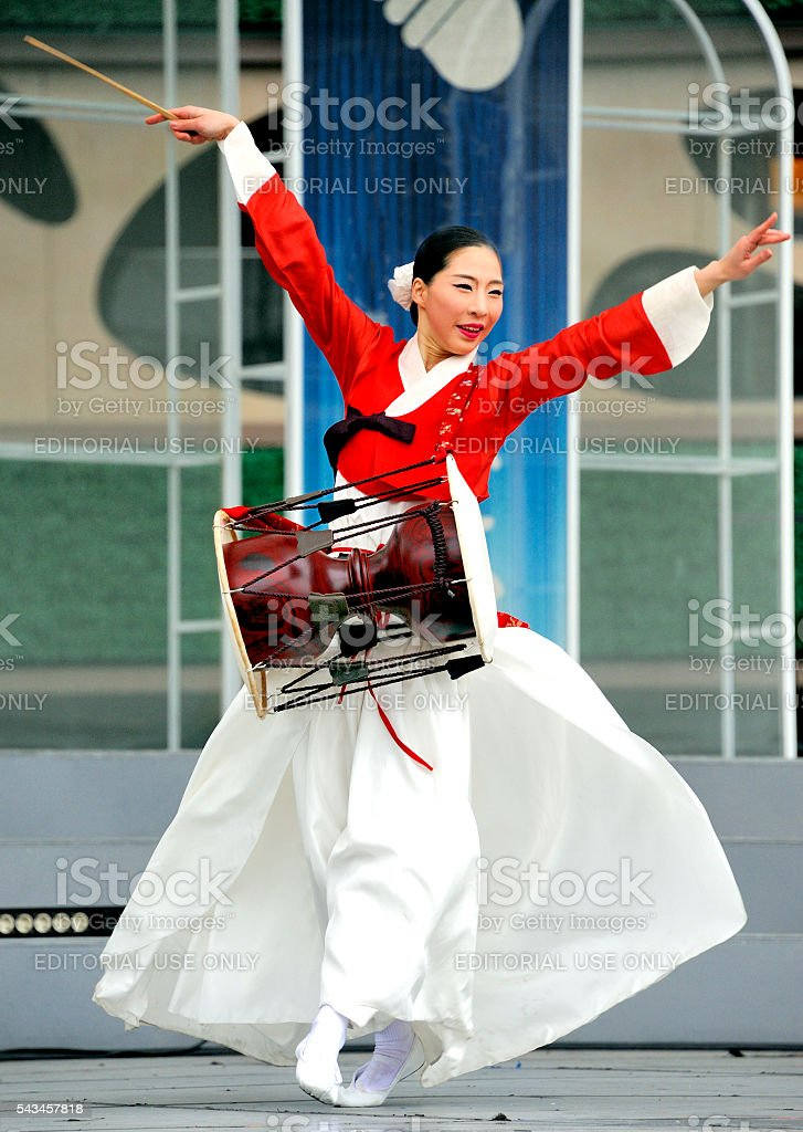 Dancing Korean woman with drum stock photo