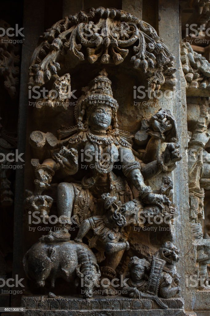 Dancing lady  sculpture under eves on shrine outer wall in the Chennakesava temple at Somanathapura,Mysore,Karnataka,India,Asia stock photo