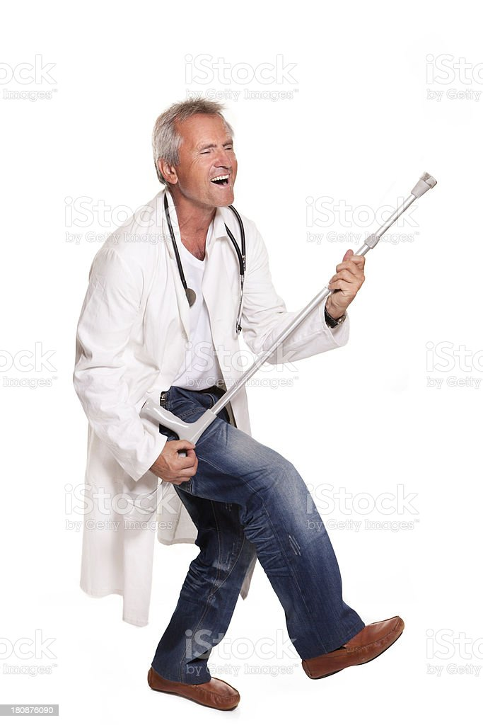 dancing mad doctor with crutches on white background royalty-free stock photo