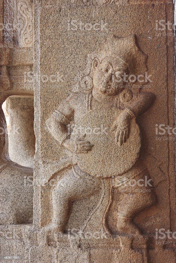 Dancing man stone carved ancient sculpture royalty-free stock photo