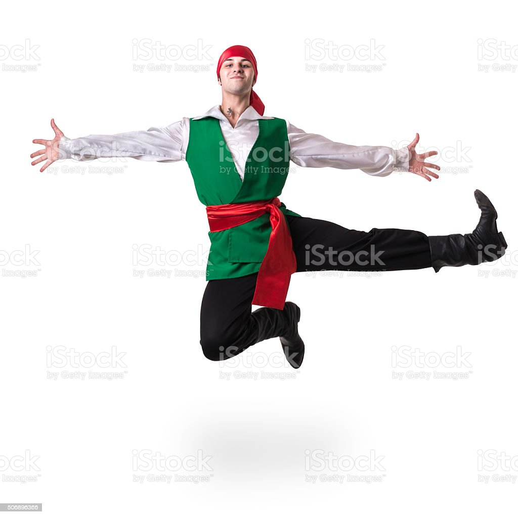 Dancing man wearing a pirate costume jumping, isolated on white stock photo