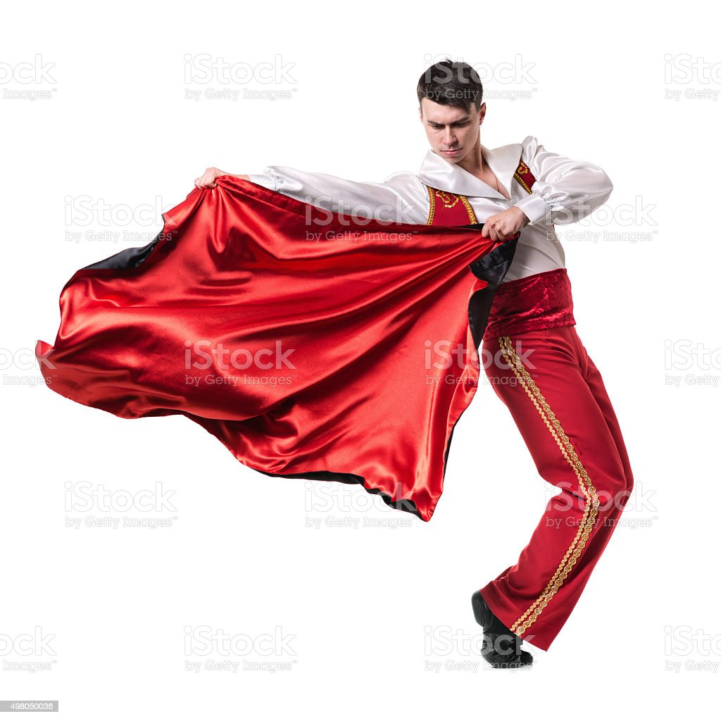 Dancing man wearing a toreador costume. Isolated on white in stock photo