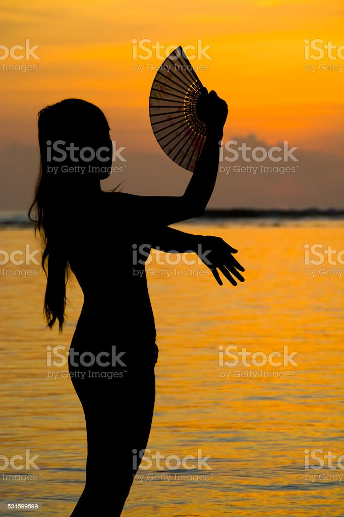 Dancing on the beach at Sunset stock photo