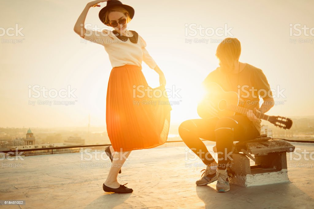 dancing on top of the city stock photo
