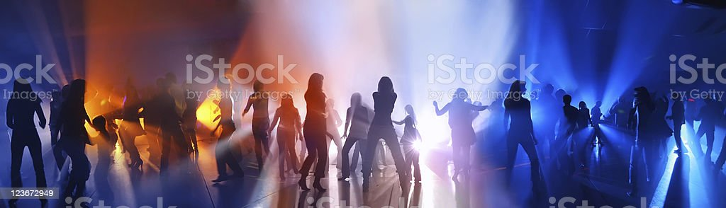 Dancing people in a disco stock photo