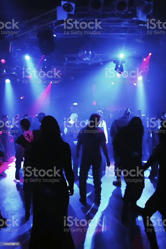 Dancing people in an underground club royalty-free stock photo