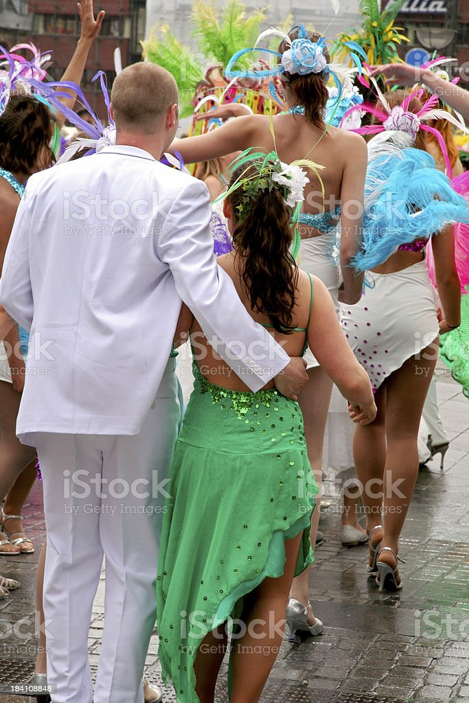 Dancing people with beautiful costumes in carnival parade royalty-free stock photo