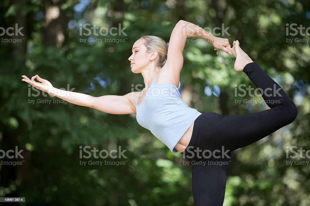 Dancing Shiva yoga pose stock photo