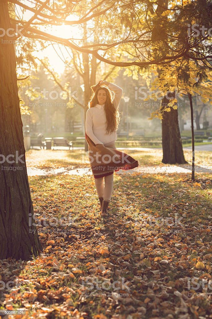 Dancing through the fallen leaves stock photo
