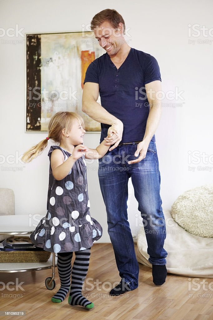 Dancing with her dad royalty-free stock photo