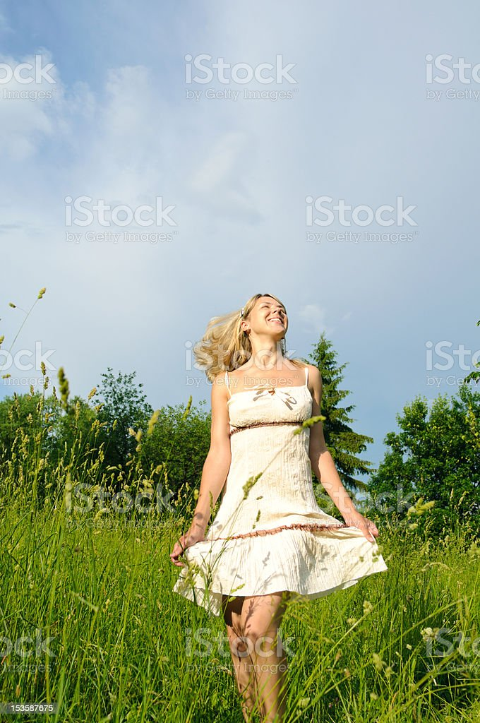 dancing woman on the meadow royalty-free stock photo