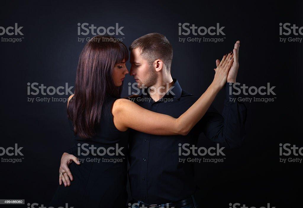 dancing young couple stock photo