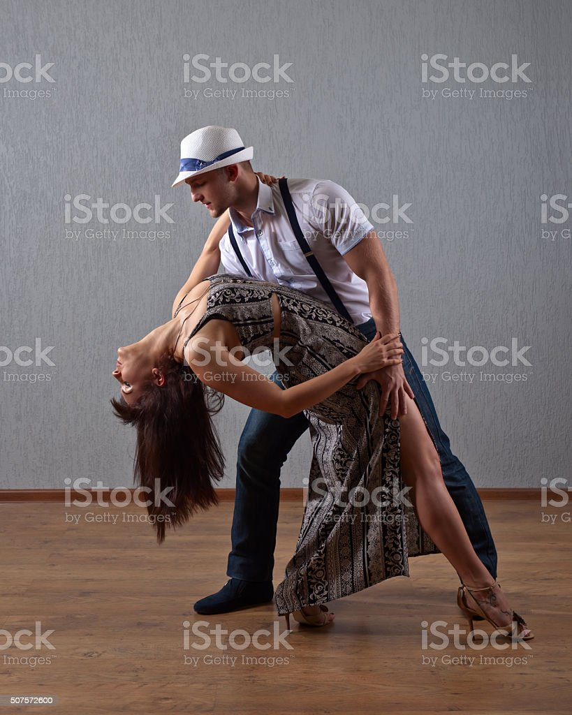 dancing young couple stock photo