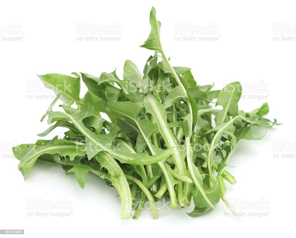 Dandelion greens isolated on white stock photo