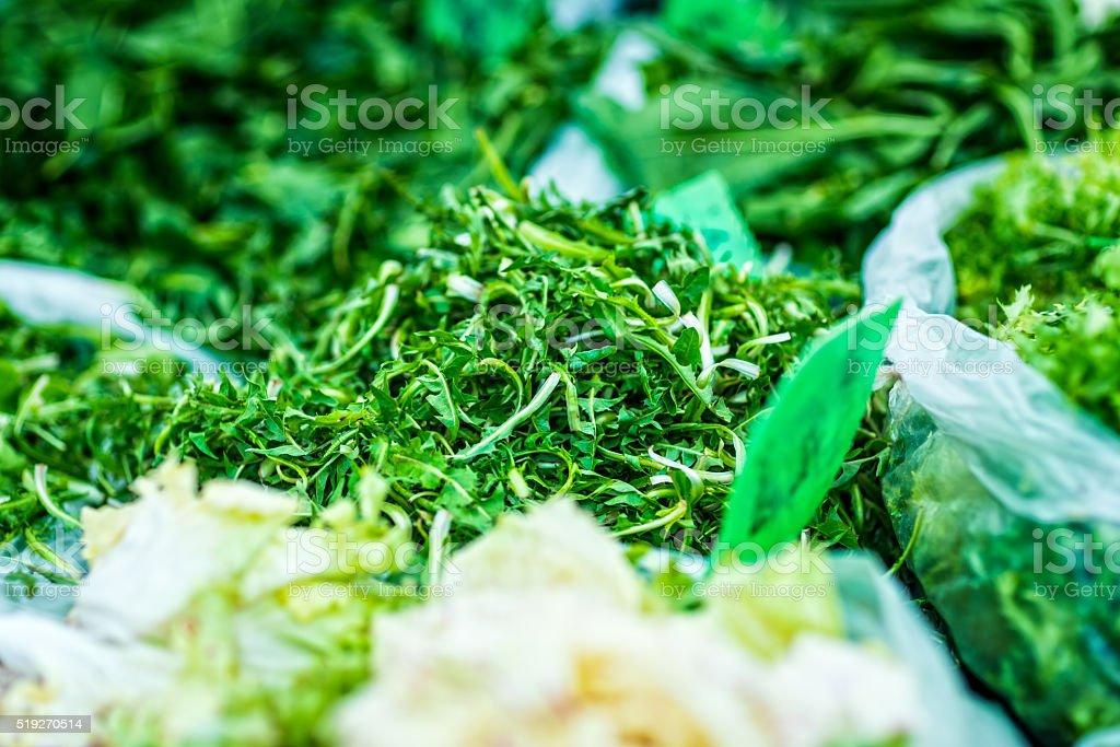 Dandelion leaves on marketplace stock photo