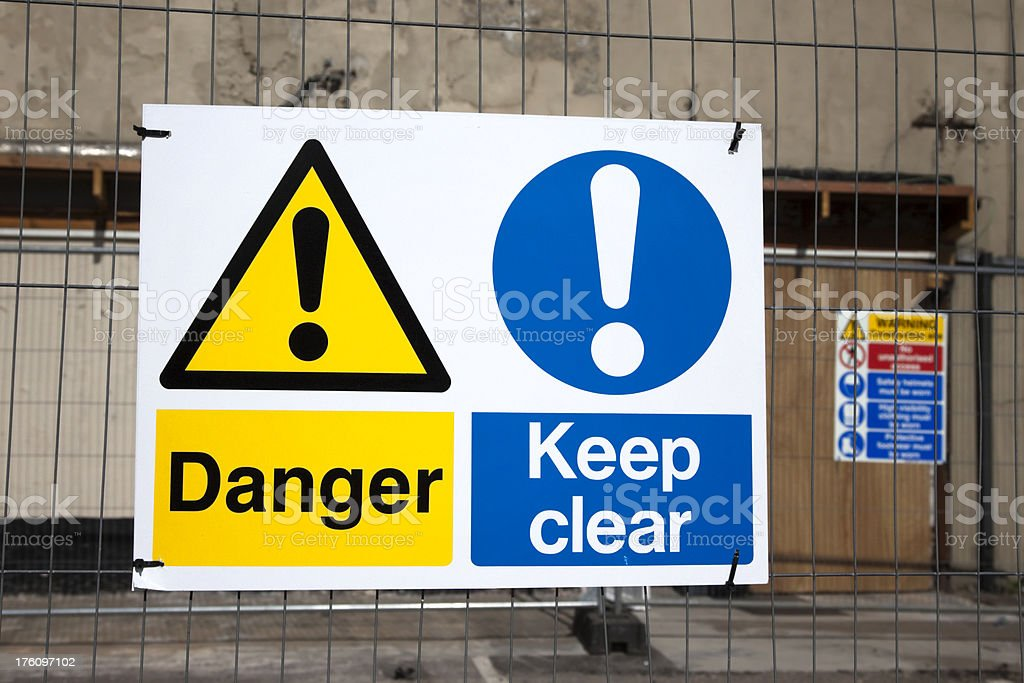 Danger and warning signs on a building site stock photo