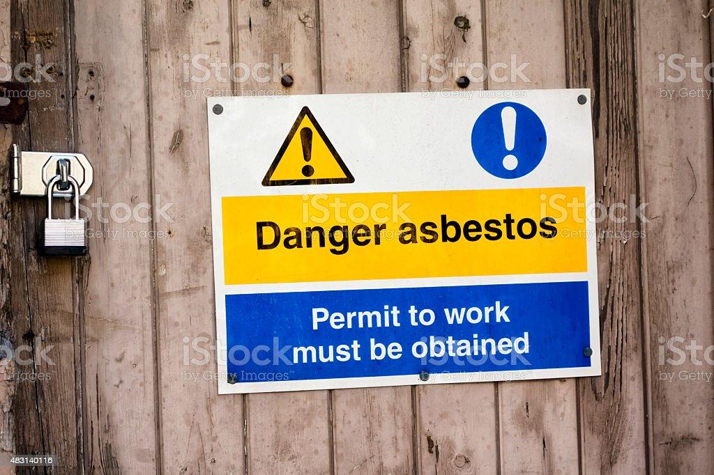 Danger asbestos - sign outside a derelict building stock photo