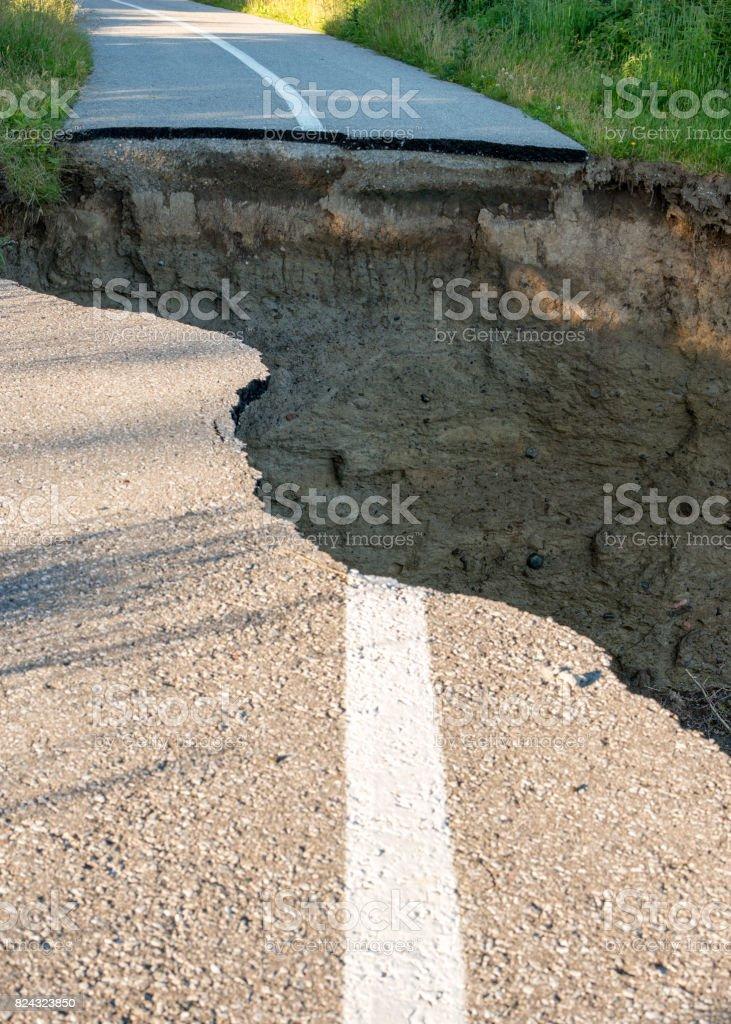 Danger - Collapsed lake side trail stock photo