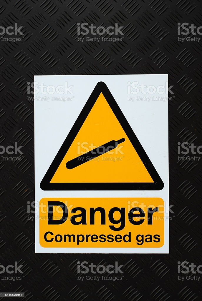 Danger compressed gas sign royalty-free stock photo
