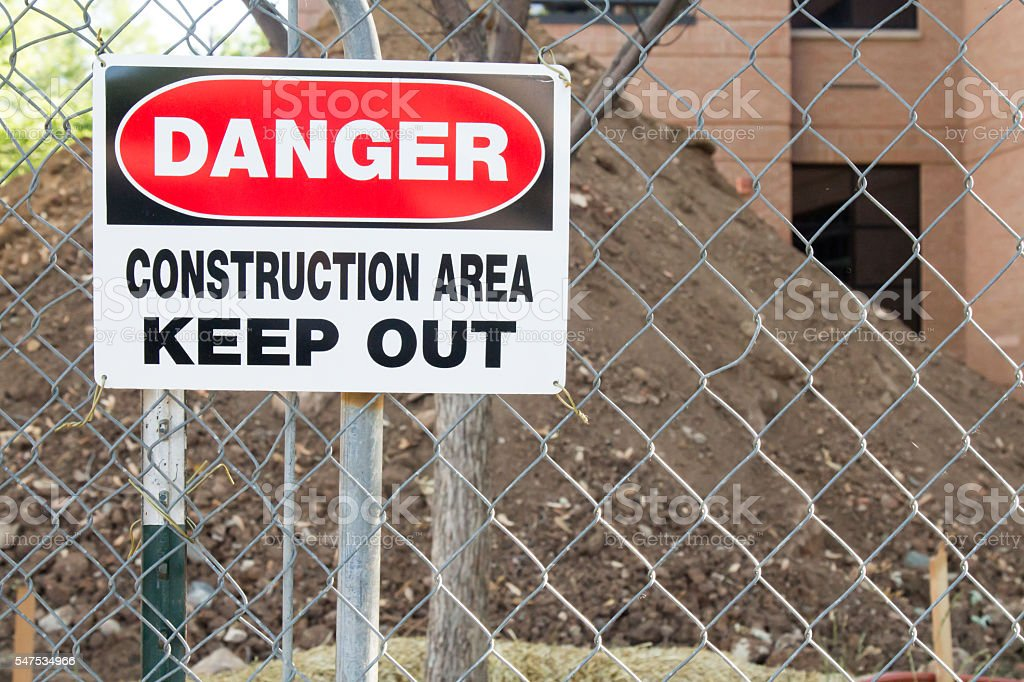 Danger Construction Area Keep Out sign on fence stock photo