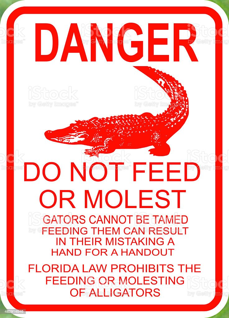 Danger do not feed the alligators sign stock photo