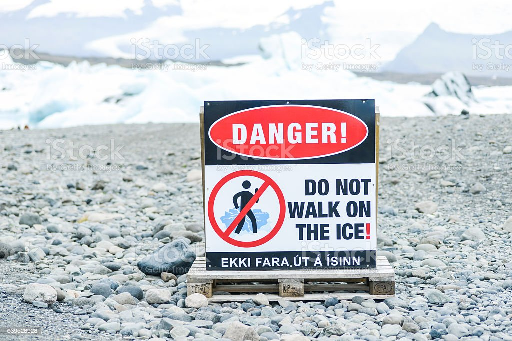 danger, do not walk on ice stock photo