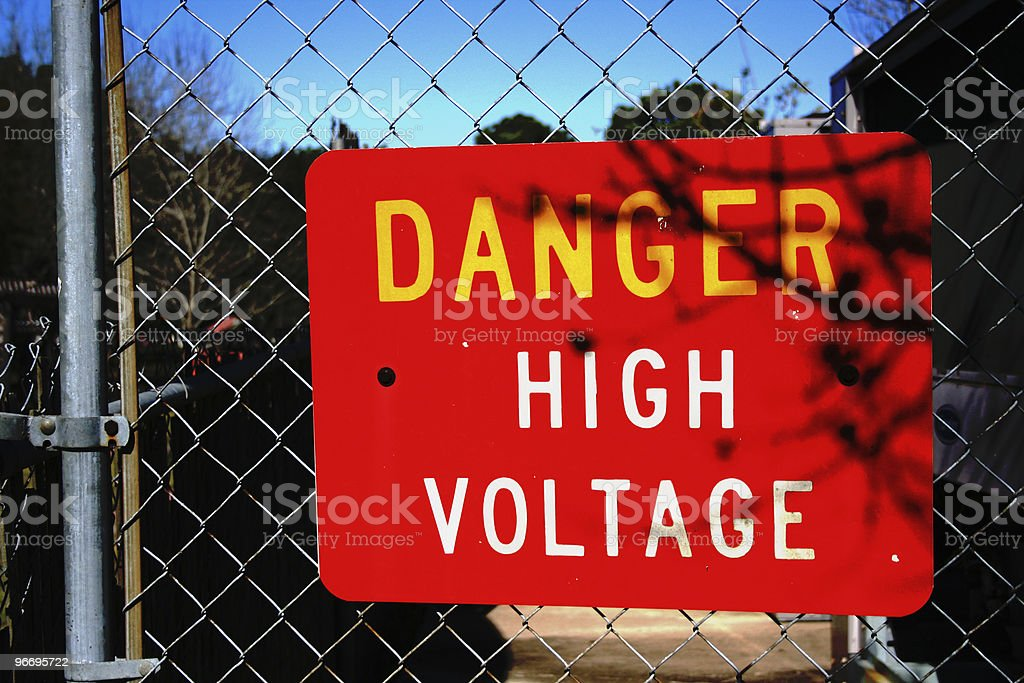 Danger High Voltage Warning Sign on Chainlink Gate stock photo