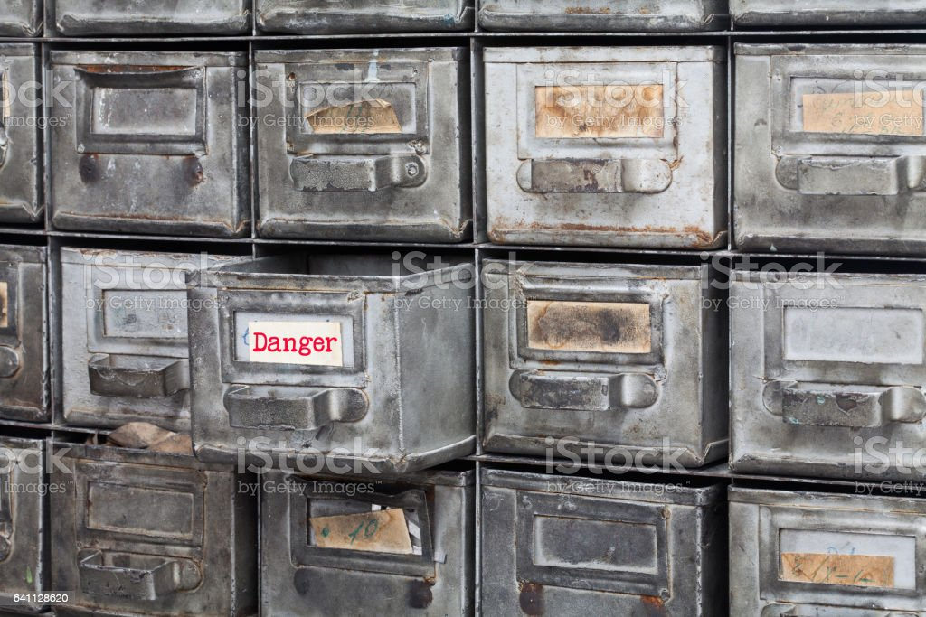 Danger information concept image. Opened box archive storage, filing cabinet interior. metal boxes with index cards. library service information management. shallow depth of field stock photo