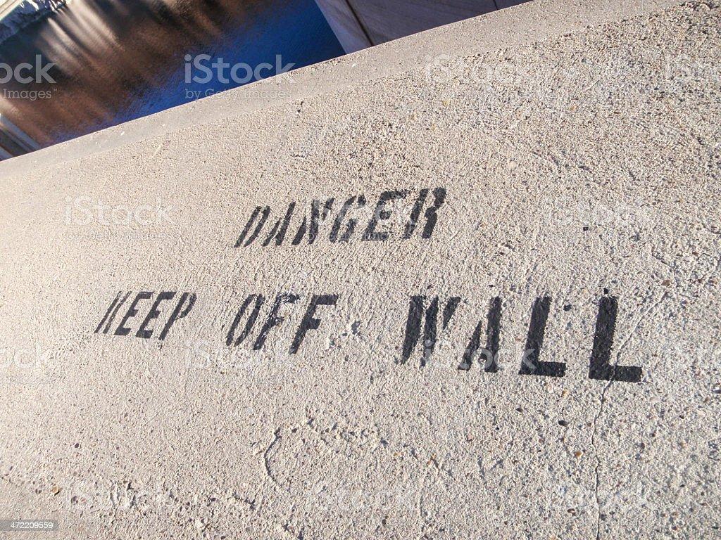 Danger! Keep off wall stock photo
