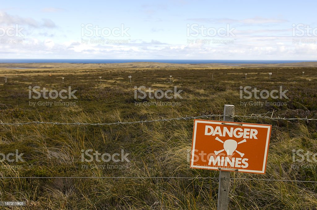 Danger Minefield with warning sign stock photo