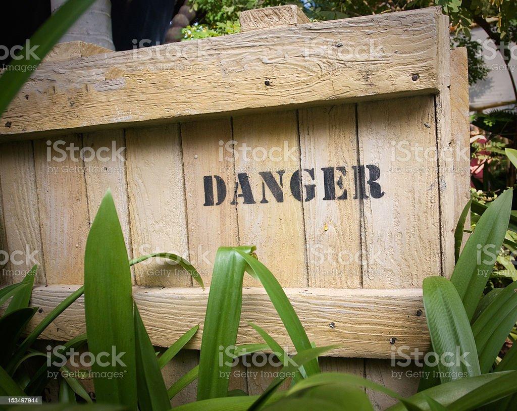 Danger on wooden box stock photo