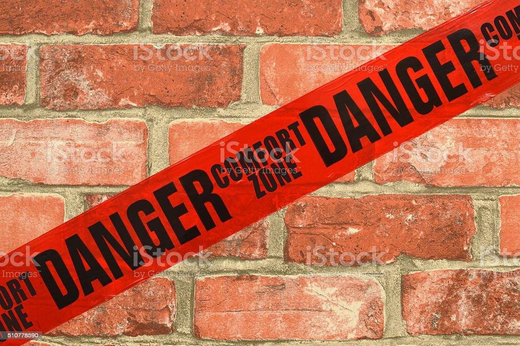 Danger Red Tape Comfort Zone Brick Wall stock photo