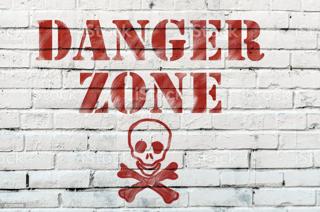 Danger Red Tape Warning in front on a white wall stock photo