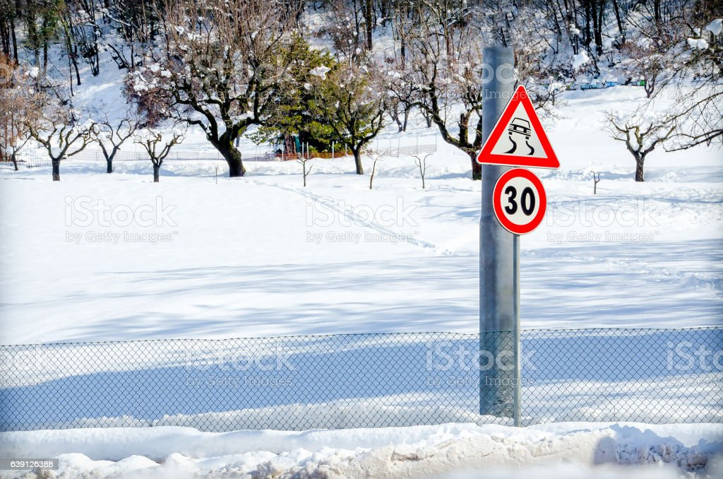 danger road sign snow stock photo