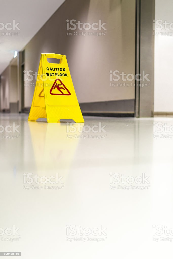 Danger sign for wet floor in a shopping mall stock photo