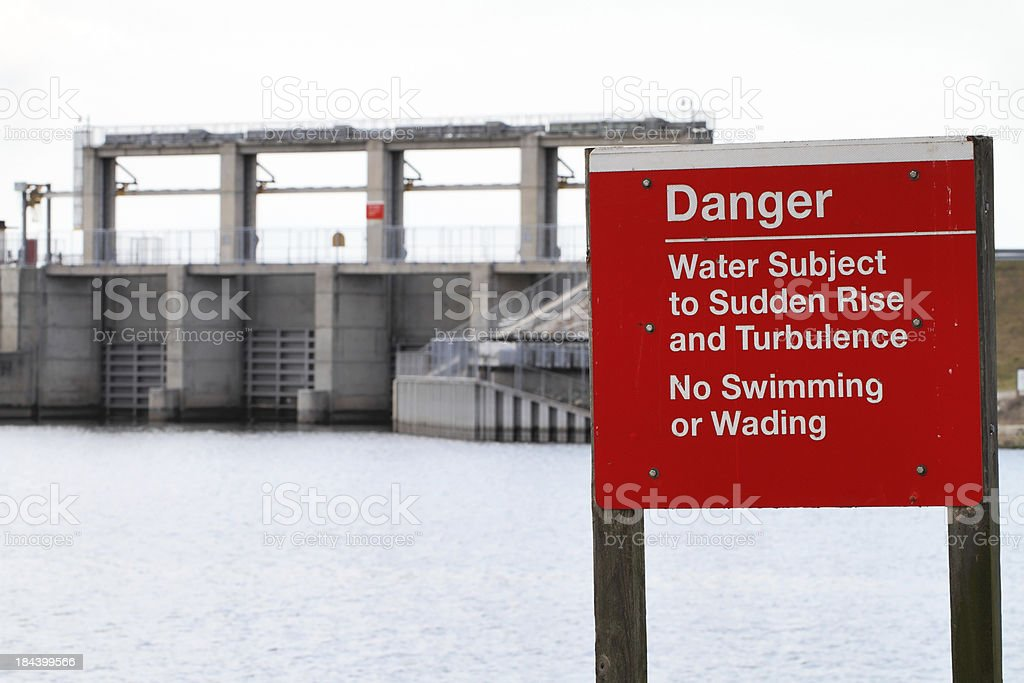 Danger sign in front of dam. stock photo