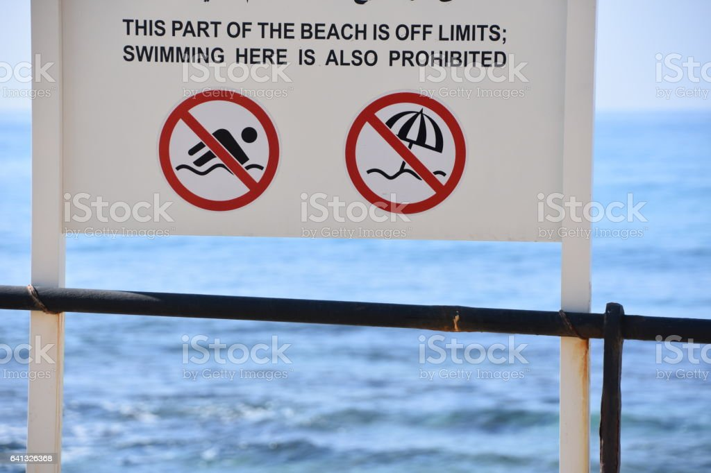 Danger sign no swiming or sitting on the beach stock photo