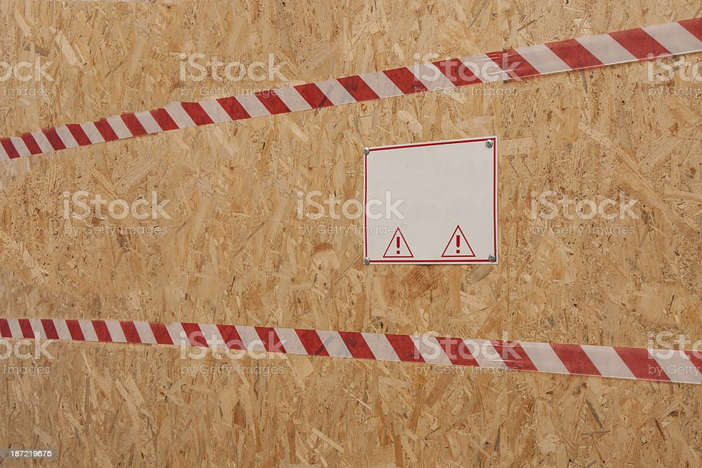 Danger sign on a wooden plate royalty-free stock photo