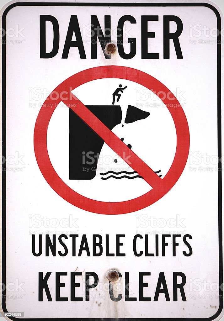 Danger sign unstable cliffs stock photo