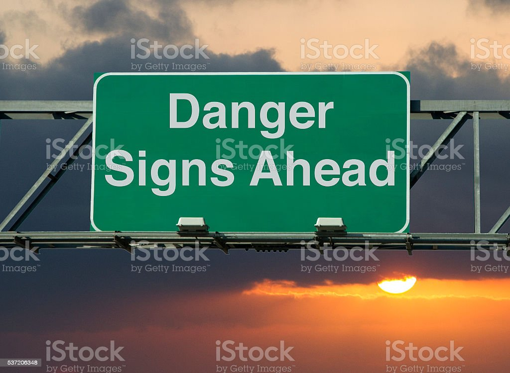 Danger Signs Ahead stock photo